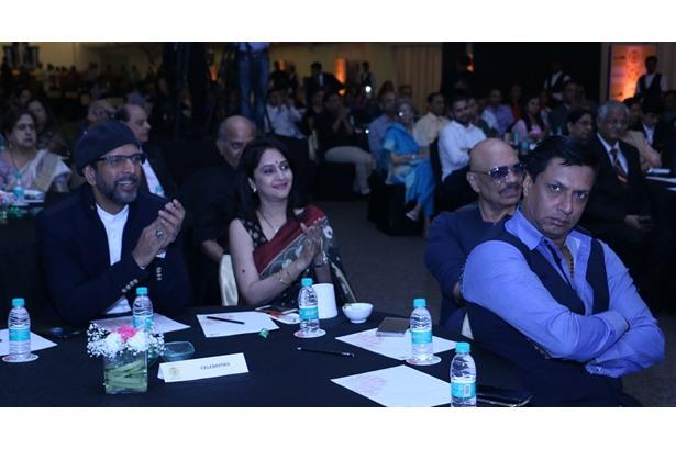 Madhur Bhandarkar and Javed Jaffrey at Cancer Patients Aid Association event.