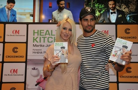 Bollywood actor Sidharth Malhotra unveils the book 'Healthy Kitchen' by Marika Johansson