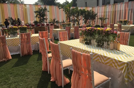 Eventwala's Simple Rustic Sundowner At Civil Lines Sees Lovely Floral Cushions & A Clean Wooden Bar