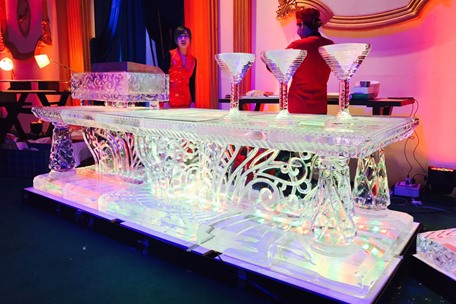 Live Cooking by CCI On A 300-Degree Hot Grill Encased in Ice by Imagine Ice!