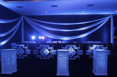 An Elegant Black & White Cocktail Illuminated with Blue Lighting by Elusive Dreams