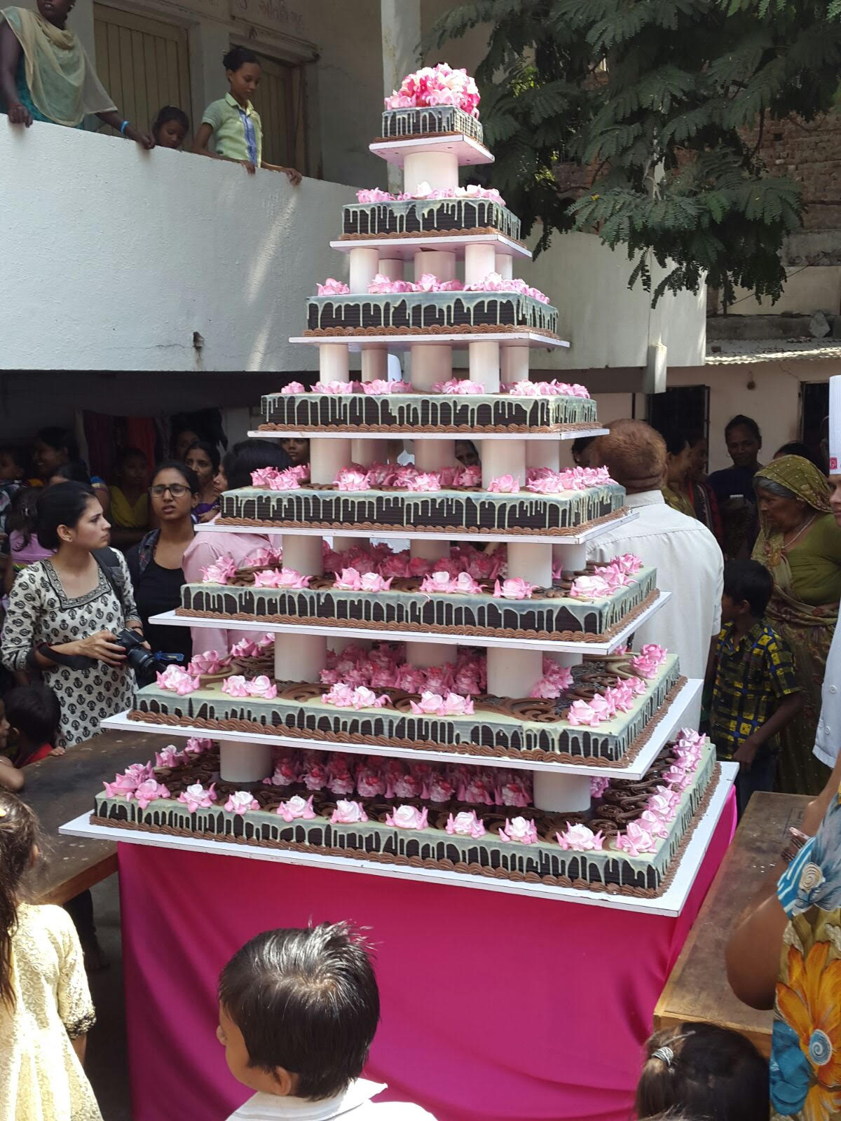 As a run up to SBI Pinkathon, a 222kg pink cake gifted to slum dwellers in Ahmedabad