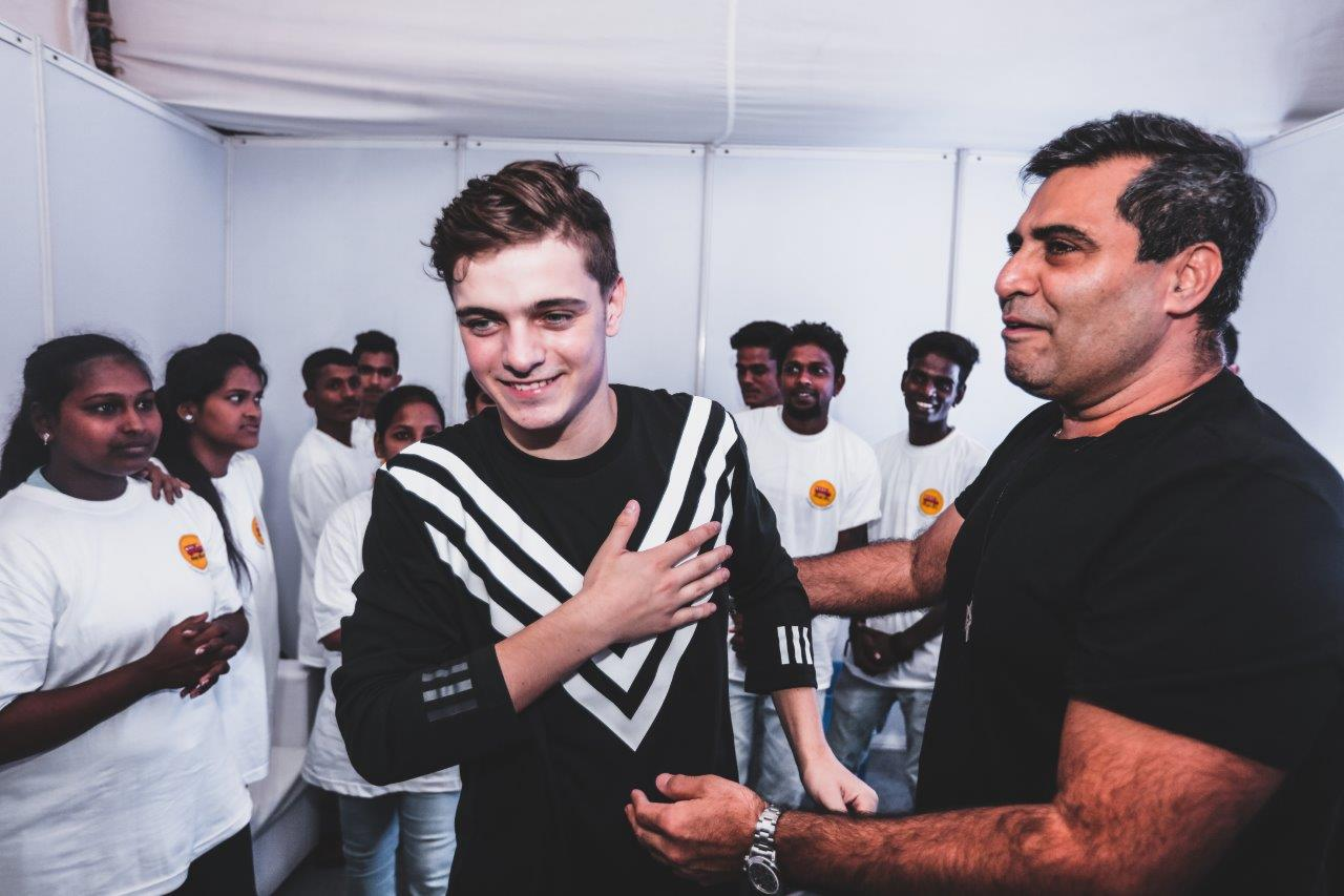 Martin Garrix Hops on the Magic Bus with Percept in a Charity Concert for 40,000+